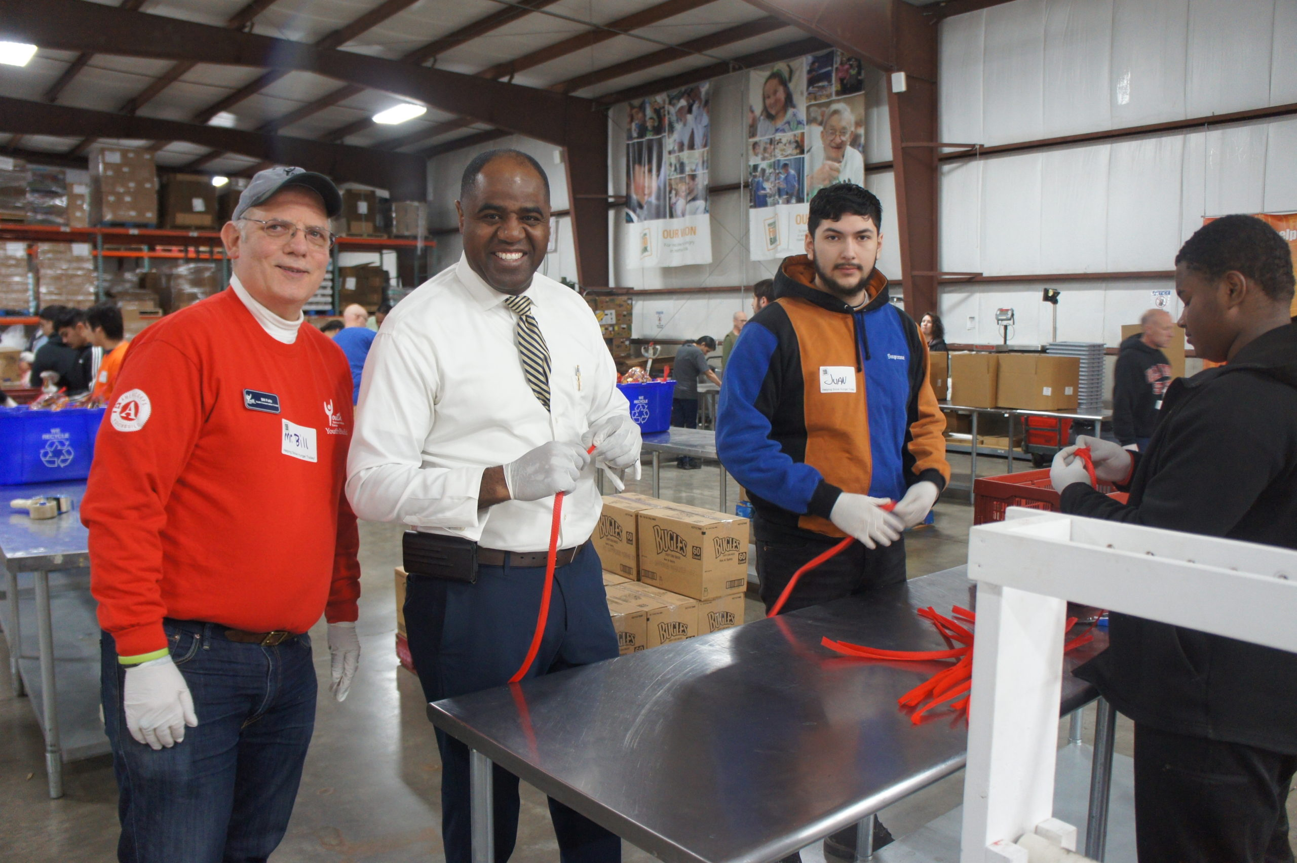 YCC Members, Staff, Waukegan Mayor Sam Cunninham Volunteer at Northern Illinois Food Bank